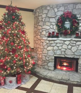 A welcoming lobby at Christmas at The Stone Castle Hotel & Conference Center in Branson, MO - Just Peachy Keen www.stayinpeachy.com