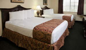 A Standard Double Queen room at The Stone Castle Hotel & Conference Center in Branson, MO - Just Peachy Keen www.stayinpeachy.com